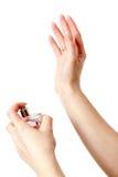 Mãos com frasco de perfume Imagem de Stock Royalty Free