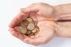 Mãos com moedas Imagens de Stock Royalty Free