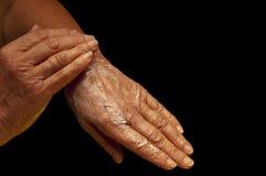 Mãos com nata Fotos de Stock Royalty Free
