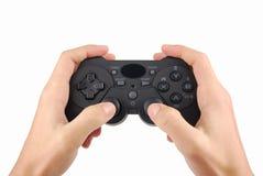 Mãos com um controlador do videogame Imagens de Stock Royalty Free