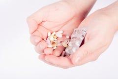 Mãos completamente das drogas imagem de stock