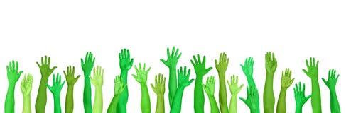 Mãos conscientes ambientais verdes levantadas Foto de Stock