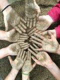 Mãos da argila das crianças Imagem de Stock