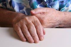Mãos da avó Imagens de Stock Royalty Free