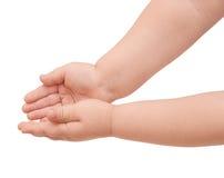 Mãos da criança pequena Fotos de Stock