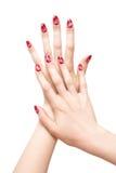 Mãos da mulher com pregos pintados Foto de Stock Royalty Free