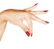 Mãos da mulher com tratamento de mãos vermelho Fotografia de Stock Royalty Free