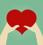 Mãos da mulher e do homem com coração Imagens de Stock