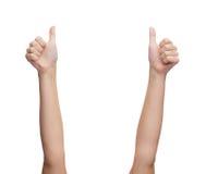Mãos da mulher que mostram os polegares acima Fotografia de Stock Royalty Free