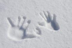 Mãos da neve foto de stock