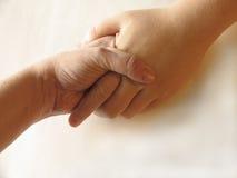 Mãos da terra arrendada Imagem de Stock