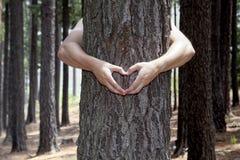 Mãos dadas forma coração Imagens de Stock