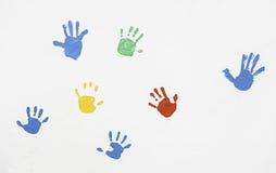 Mãos das cores pintadas na parede Imagem de Stock Royalty Free