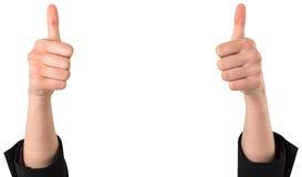 Mãos de Businesswomans que mostram os polegares acima Imagens de Stock Royalty Free