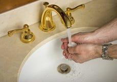 Mãos de lavagem Imagem de Stock