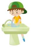 Mãos de lavagem do menino no dissipador ilustração royalty free