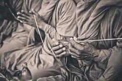 Mãos de rezar da monge Imagem de Stock