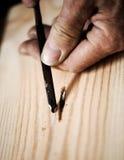 Mãos de um artesão Fotos de Stock Royalty Free