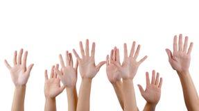 Mãos do aumento dos povos no ar imagens de stock