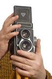 Mãos do estúdio da fotografia da foto da câmera Fotos de Stock Royalty Free
