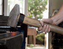 Mãos do ferreiro pelo trabalho Fotos de Stock Royalty Free