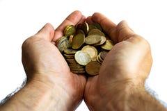 Mãos do homem acima do fim que guarda euro- moedas isoladas imagem de stock royalty free