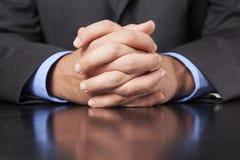 Mãos do homem de negócios Clasped imagens de stock royalty free