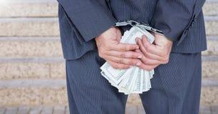 Mãos do homem de negócios nas algemas que guardam dólares americanos Foto de Stock Royalty Free