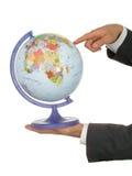 Mãos do homem de negócios que prendem o globo fotos de stock royalty free