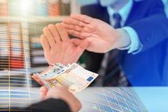 Mãos do homem de negócios que rejeitam uma oferta do dinheiro; exposição múltipla foto de stock royalty free