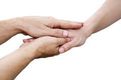 Mãos do homem novo que guarda a mão fêmea Imagens de Stock Royalty Free