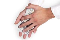 Mãos do homem que cobrem o dinheiro da pilha Imagem de Stock Royalty Free