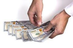 Mãos do homem que contam o dólar Fotografia de Stock