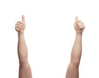 Mãos do homem que mostram os polegares acima Foto de Stock Royalty Free