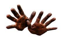 Mãos do mecânico sujas do petróleo. Fotos de Stock
