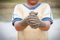 Mãos do menino imagens de stock