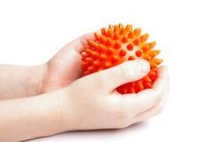 Mãos do menino com esfera da massagem Fotos de Stock