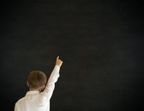 Mãos do menino de escola que respondem acima à pergunta Foto de Stock