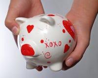 Mãos do miúdo com banco piggy #3 fotos de stock royalty free