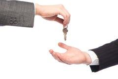 Mãos do negócio com chaves imagens de stock royalty free