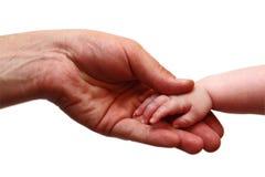 Mãos do pai e do bebê Imagens de Stock