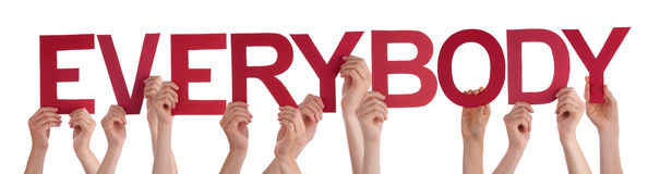 Mãos dos povos que guardam a palavra reta vermelha todos Imagens de Stock
