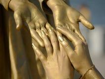 Mãos douradas Imagem de Stock Royalty Free
