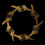 Mãos douradas no círculo Foto de Stock Royalty Free
