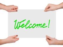 Mãos e boa vinda da bandeira Imagens de Stock Royalty Free