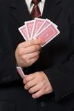 Mãos e cartão na luva Fotografia de Stock Royalty Free