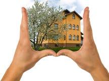 Mãos e casa Foto de Stock Royalty Free