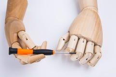 Mãos e chave de fenda de madeira Imagens de Stock Royalty Free