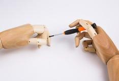 Mãos e chave de fenda de madeira Imagem de Stock