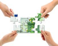 Mãos e enigma do dinheiro Imagens de Stock Royalty Free